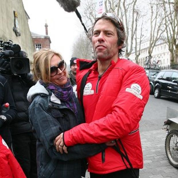 John Bishop was greeted by wife Mel as he arrived in London