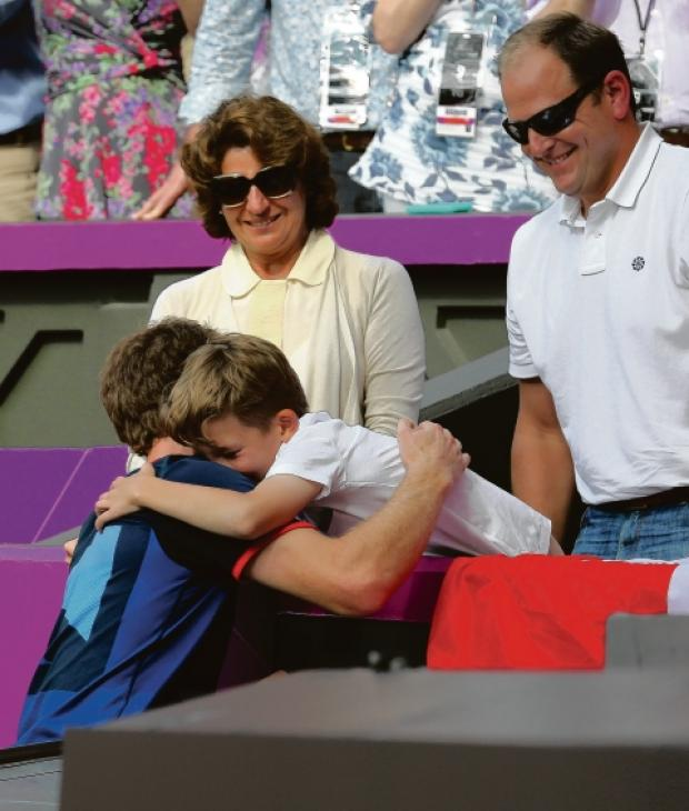Henry Caplan hugs Andy Murray after his Olympic win