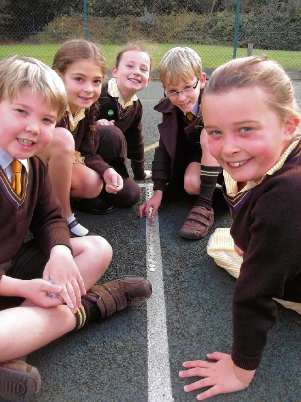 Pupils with some of their coins