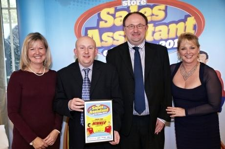 Melanie Mills of JTI, Simon Sims, Convenience Store editor David Rees, and TV presenter and Sales Assistant host Cheryl Baker after Simon won one of his prizes