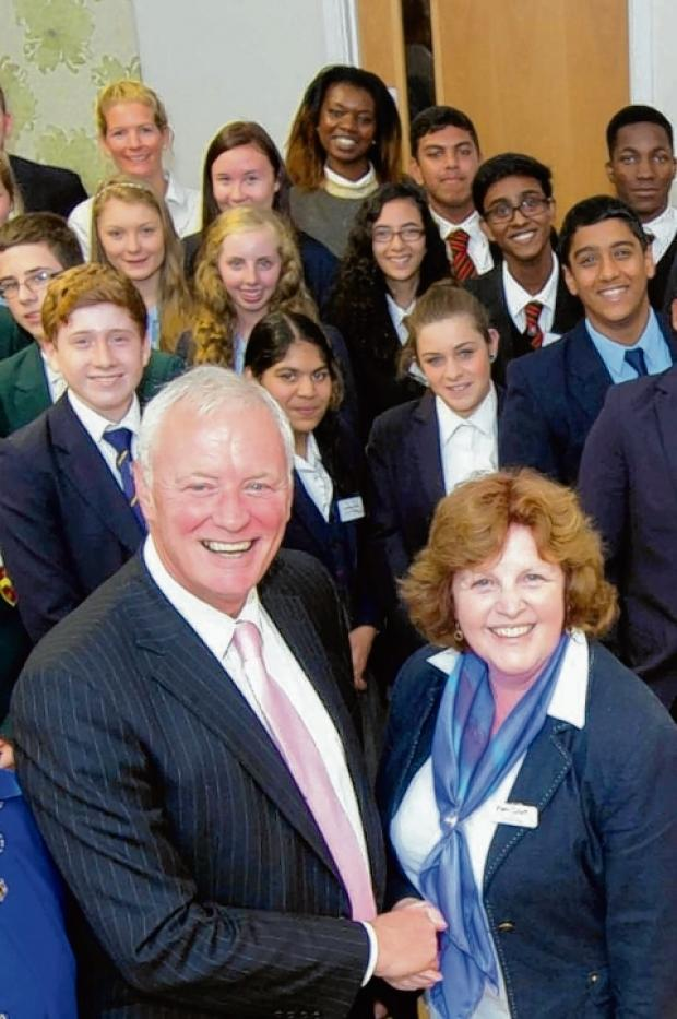 Barry Hearn and Saint Francis Hospice's Pam Court with some of the budding entrepreneurs