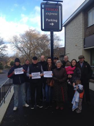 Campaigners outside the Tesco Express in Hanging Hill Lane