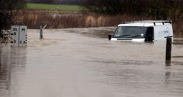 The van had to be pulled out five feet of rising flood waters [Pics: Stephen Huntley]