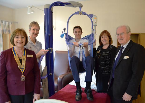 Student Nurse Craig Ware demonstrates the hoist which was bought through a donation by Brentwood a Becket Rotary Club