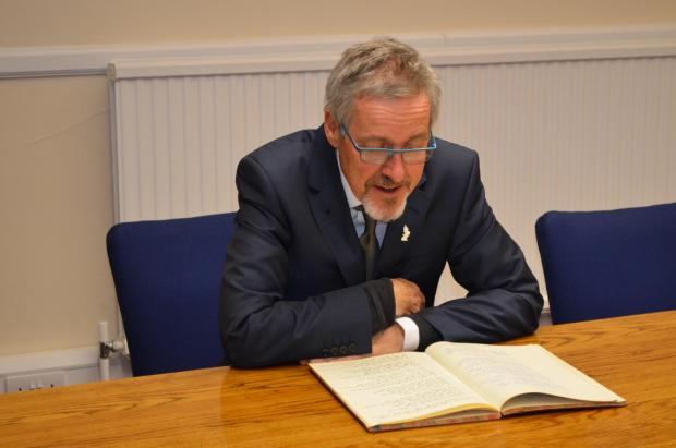 Griff Rhys Jones reading back through his old school work in Brentwood