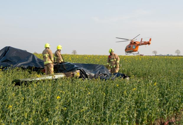 Picture from Essex Fire and Rescue of crews working at the scene of the fatal plane crash