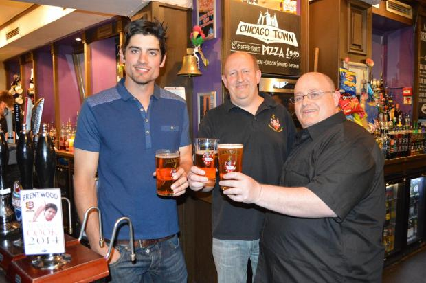 Alastair Cook with Roland Kannor (centre) from the Brentwood Brewing Company and Brett Sanders, manager of the Golden Fleece, toasting the England captain's benefit year beer