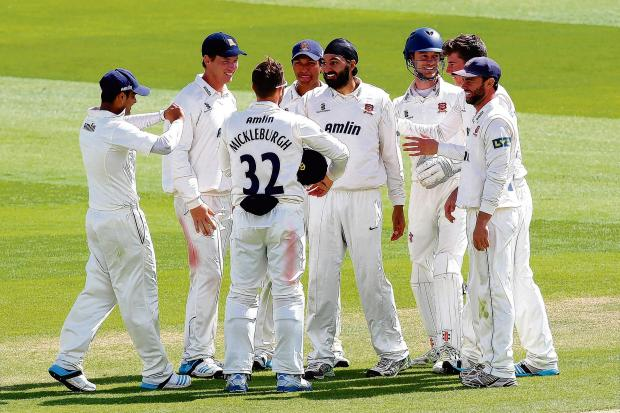 Well done — Monty Panesar is congratulated on the wicket of Jigar Naik, one of six Leicestershire batmen's scalps he claimed on day three at Chelmsford. Picture: GAVIN ELLIS/TGS PHOTO
