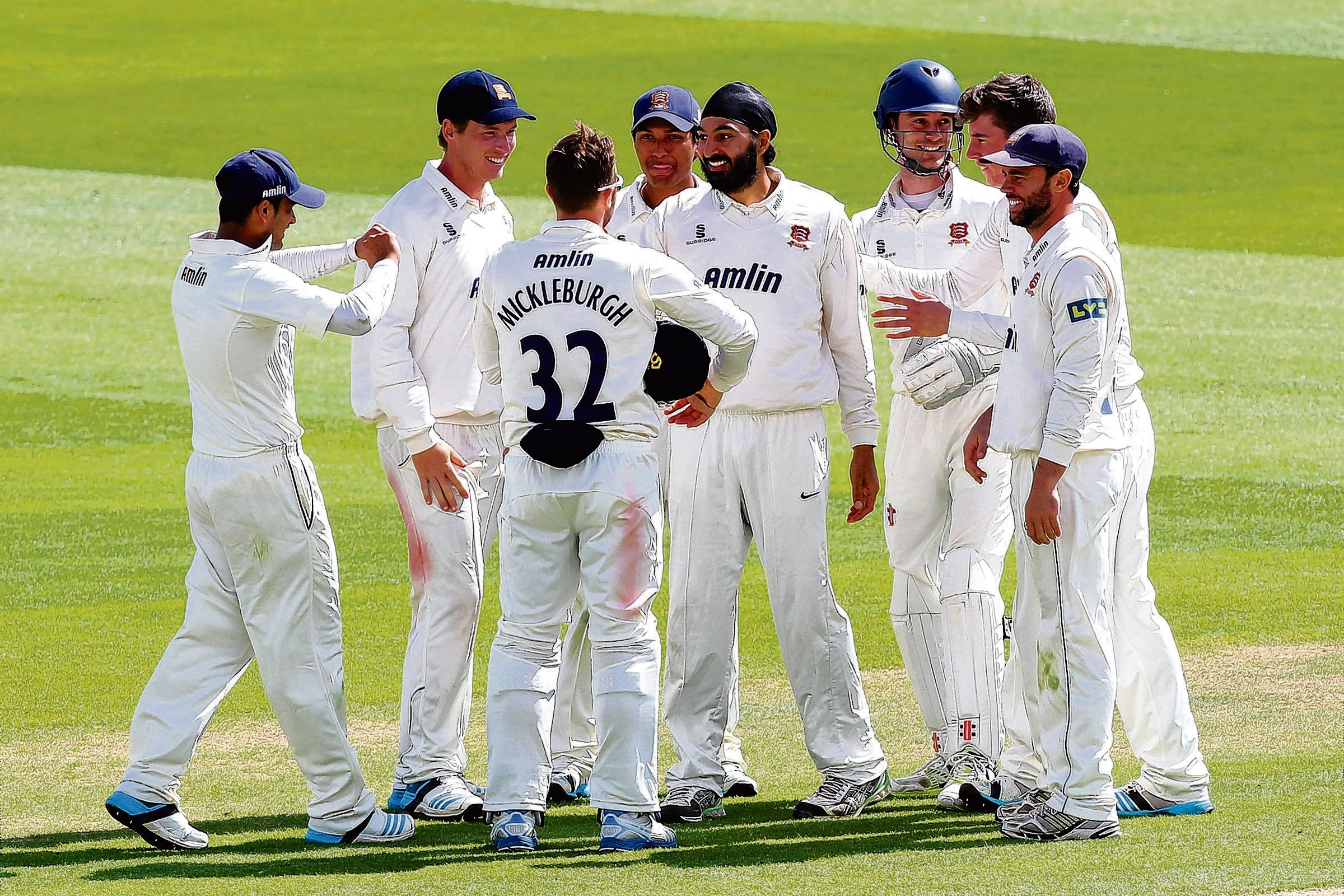 Well done — Monty Panesar is congratulated on the wicket of Jigar Naik, one of six Leicestershire batmen's scalps he claimed on day three at Chelmsfo