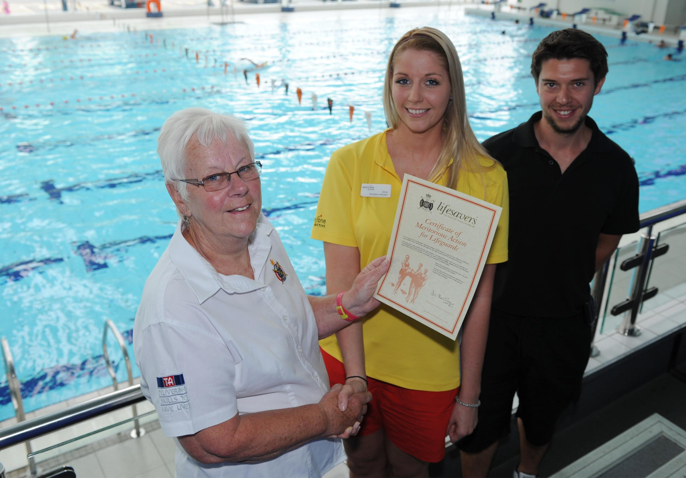 Hero – Emily Jones with Val Hardy, from the Royal Life Saving Society and David Tracey