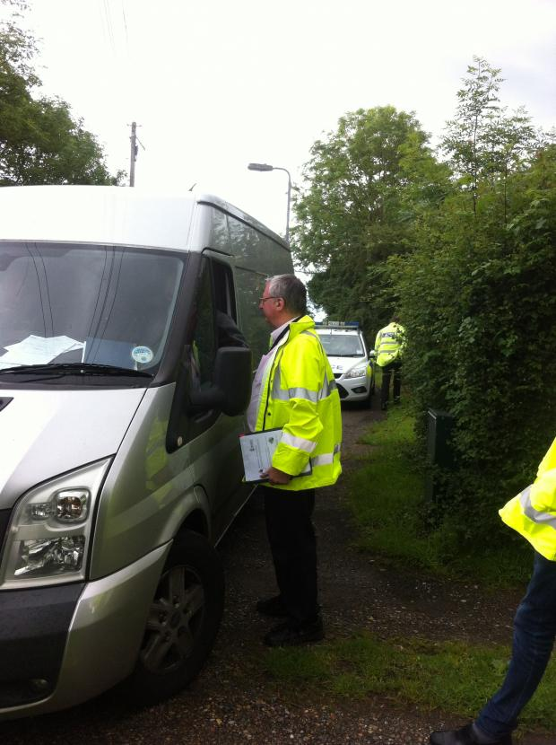 Brentwood Weekly News: Enviromental officers checking one of the vehicles