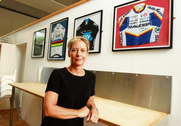 Sue Fearnley stands proudly with her jerseys