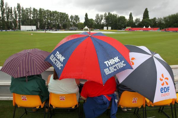 Spectators group underneath umbrellas at Colchester. PIC: GAVIN ELLIS/TGS PHOTOS