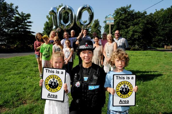Mahalah Perkins, PC Michelle Rawson and Elijah Perkins with Stambridge villagers celebrating 100 per cent Neighbourhood Watch coverage