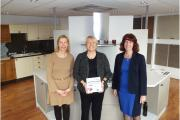 Suzan Hearson (centre) presented with the Low Carbon Business plaque by Elaine Richardson, Brentwood Town Centre and Marketing Manager at Brentwood Borough Council (left) and Anne Knight, Economic Development Manager at Brentwood Borough Council (right).