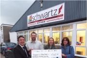 Anne Knight and Elaine Richardson from Brentwood Borough Council's Economic Development Team present Chris Futcher and Daren Bilner from Schwartz Printing with a Low Carbon Business cheque.